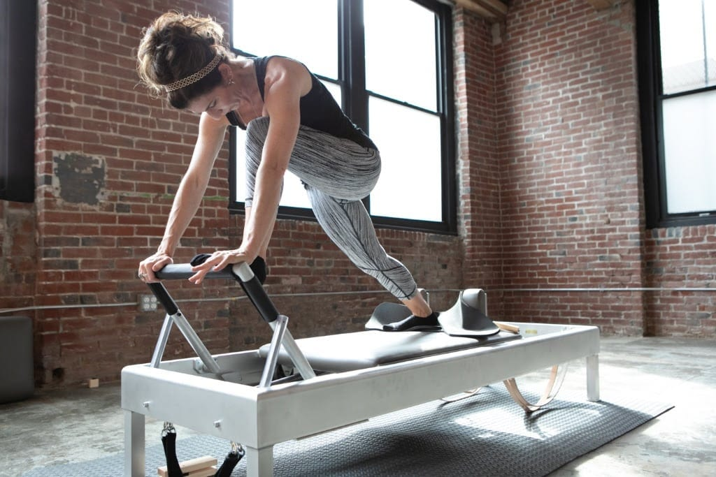 Brie Neff owner Equilibrium Pilates Philadelphia using the Archive Reformer by Gratz