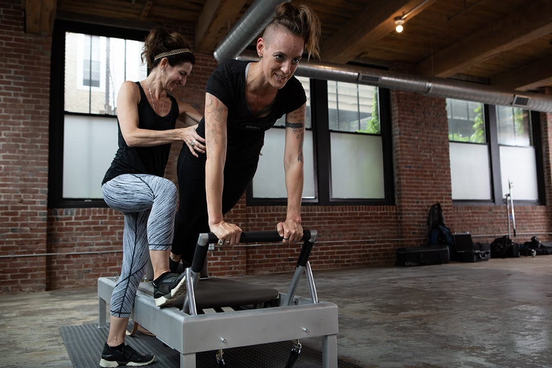 Brie spotting Equilibrium Pilates instructor Patience Owen on Gratz Archive Reformer